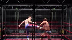 Hard kick to face - Pro wrestling match Stock Footage
