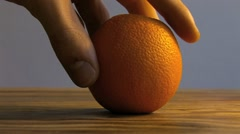 Placing an Orange HD Stock Footage