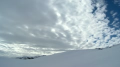 Stock Video Footage of Mountains covered with snow and clouds above timelapse
