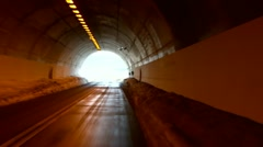 Exiting the tunnel to roads fenced with a large layers of snow - stock footage