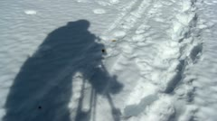 Shadow of a cameraman on the snow Stock Footage