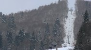 Skiers on the ski lifts at ski centre Stock Footage