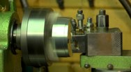 Stock Video Footage of chuck turning on a lathe, seamless loop, starts and stops