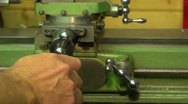 Turning the feed handle on a lathe, mid shot Stock Footage