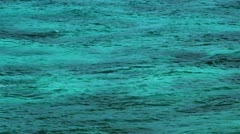 110 Small waves while  windless weather in the blue sea Stock Footage