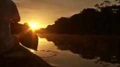 Paddeling On Amazon In Sunset Stock Footage