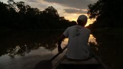 Indio with Canoe On Amazon River In Sunset Stock Footage