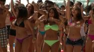 Beautiful models danceing on the beach Stock Footage