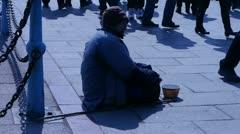 Beggar woman sitting on ground. Stock Footage
