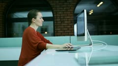 Woman surfing the net on computer in modern office - stock footage