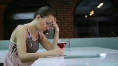 Sad lonely woman drinking wine in bar Stock Footage