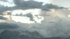 Clouds over rocky mountain Stock Footage