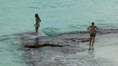 2 girls moisten his feet in the Caribbean Sea. Cuba, Cayo Largo Stock Footage