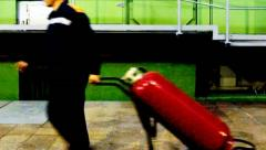 Worker Pulls Fire Extinguisher Stock Footage