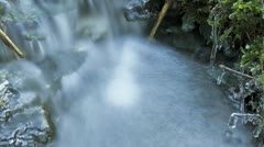 Timelapse of blurred waterfall in a small creek Stock Footage