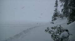 Snowstorm on snowy lake - stock footage
