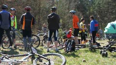 Cyclists chatting before race Stock Footage
