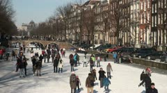 Canals in Amsterdam - people on the ice on a beautiful day Stock Footage