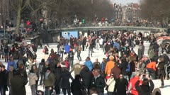 Weekend crowds on frozen canals in Amsterdam, Holland Stock Footage