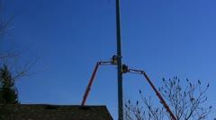 Communication workmen installing rf antennas Stock Footage