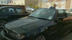 Polishing a car (glidecam three) Model release Stock Footage