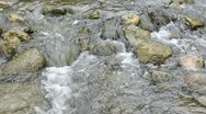 Stones in the river and water splash Stock Footage