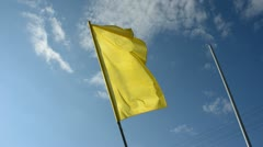 Yellow flag on sky and wind Stock Footage