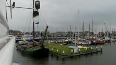 Sailing into harbour Marken Stock Footage