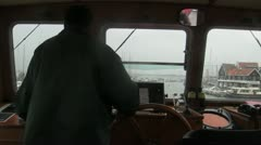 Captain on bridge of boat Stock Footage