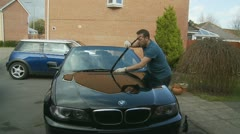 Polishing a car (glidecam nine) Model release Stock Footage