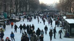 Winter in Amsterdam, the Netherlands, crowds of people having fun on the ice Stock Footage