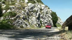 Montenegro, red car on a mountain road Stock Footage