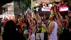 People cheering for beads on Bourbon Street Stock Footage