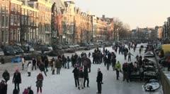 Amsterdam frozen canals in Winter, Dutch scene, Holland, Netherlands Stock Footage