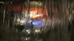 View of the city at night through the jet fountain Stock Footage