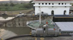 A Commercial Cargo Ship Passes Through The Miraflores Panama Canal Lock Stock Footage