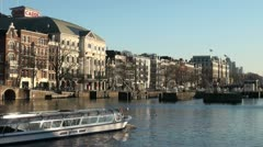 Reflection of a tourist boat going through Amsterdam's canals Stock Footage