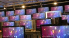 MY FOOTAGE INSERTED ON SCREENS of many flat tv sets stay working Stock Footage