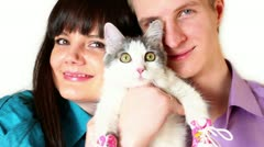 Young boy and girl hold cat in pink shoes Stock Footage