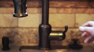 Man Fills up Glass at Kitchen Sink Stock Footage