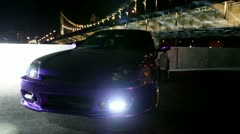 Car stand with parking lights blinks at background of bridge Stock Footage