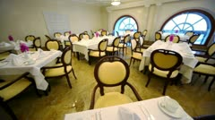 Many chairs and tables in empty restaurant Stock Footage