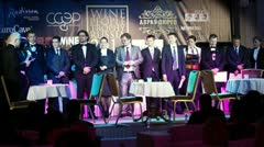 Narrator speaks with several sommeliers at Wine People Trophy Russia 2011 Stock Footage