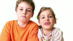Two kids boy and girl smile isolated - stock footage