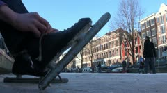 Putting on ice skates in Amsterdam - stock footage
