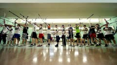 Stock Video Footage of Many sportsmens archers stand in shooting gallery on IV Traditional archery
