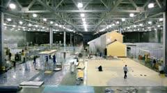 Labourers work on building site in exhibition hangar Stock Footage