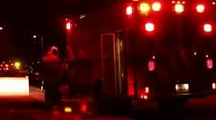Fireman by Ambulence at Night - stock footage