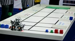 Referee watch on robot moves and stack at table Stock Footage