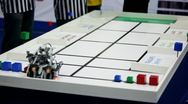 Stock Video Footage of Referee watch on robot moves and stack at table
